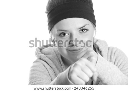 Punch - This is a black and white shot of a cute young woman in a fighting stance. Shot on an isolated white background. - stock photo