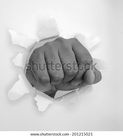 Punch through paper , black and white , B&W - stock photo