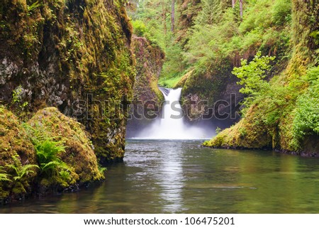 Punchbowl Falls in Eagle Creek near the Columbia River Gorge and Portland Oregon is a roaring experience. - stock photo
