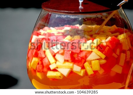 punchbowl with melon and pineapple