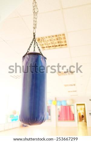 Punching bag for boxing isolated on white background - stock photo