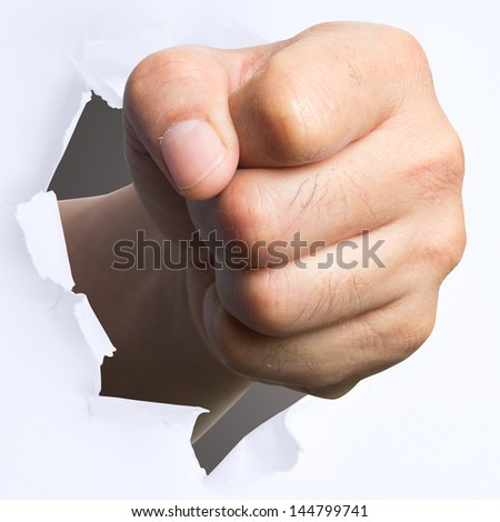 punching though over white paper for show concept solve problem - stock photo
