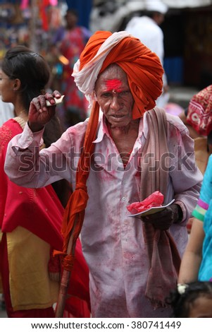 Pune, India - July 11, 2015: An old Indian pilgrim in a traditional attire during a religious wari pilgrimmage festival in India