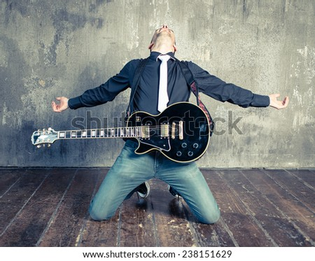 punk artist with electric guitar. concept about music and entertainment - stock photo