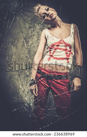 Punk girl behind broken glass  - stock photo