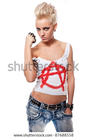 Punk girl with a brass knuckles. - stock photo