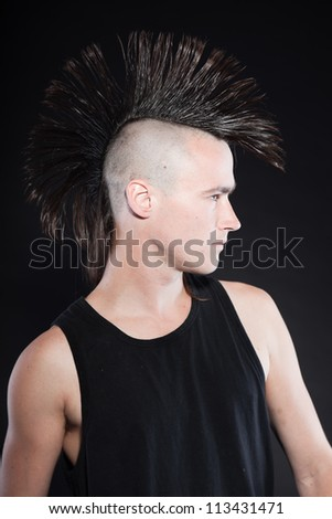 with mohawk haircut. Black shirt. Expressive face. Isolated on black ...