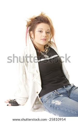 Punk style girl sitting on white floor looking to camera