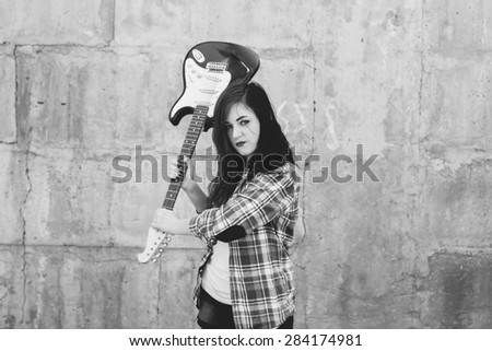 punk young woman with guitar  - stock photo