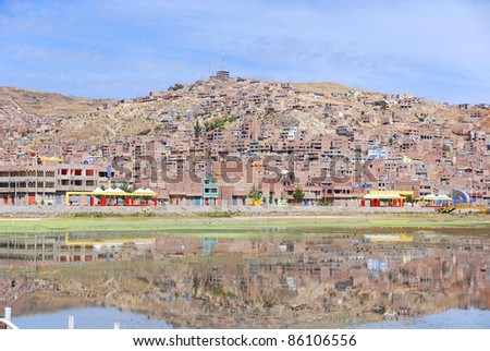 Puno is a city in southeastern Peru, located on the shore of Lake Titicaca. It is the capital city of the Puno Region and the Puno Province with a population of approximately 100,000. - stock photo