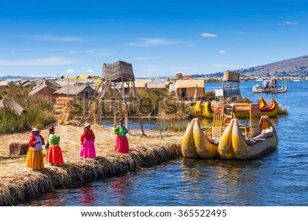 PUNO, PERU - MAY 14, 2015: Unidentified women in traditional dresses welcome tourists in Uros Island. - stock photo