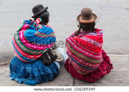 PUNO, PERU: Women with traditional clothes. - stock photo
