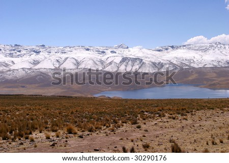 Puno way with snowy mountains in the background - stock photo