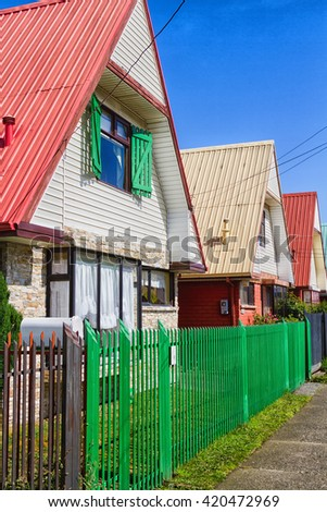 PUNTA ARENAS, CHILE - JANUARY 24, 2016: Row of vivid colourful timber, wooden houses, Punta Arenas, Patagonia, Chile. Lighted by warm summer light.