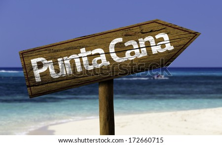 Punta Cana, Dominic Republic wooden sign with the beach on background - stock photo