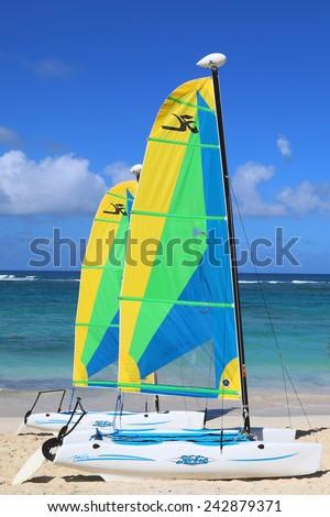 PUNTA CANA, DOMINICAN REPUBLIC - DECEMBER 31, 2014: Hobie Cat catamaran ready for tourists at Bavaro Beach in Punta Cana. The Dominican Republic is the most visited destination in the Caribbean  - stock photo