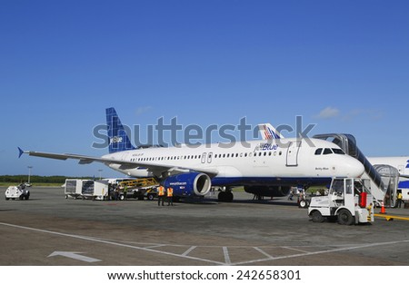 PUNTA CANA, DOMINICAN REPUBLIC - DECEMBER 30, 2014: Jetblue Airlines Airbus 320 at Punta Cana International Airport. The Dominican Republic is the most visited destination in the Caribbean  - stock photo
