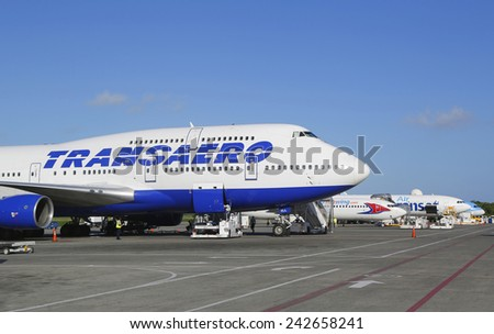 PUNTA CANA, DOMINICAN REPUBLIC - DECEMBER 30, 2014: Numerous planes landed at Punta Cana International Airport. The Dominican Republic is the most visited destination in the Caribbean  - stock photo