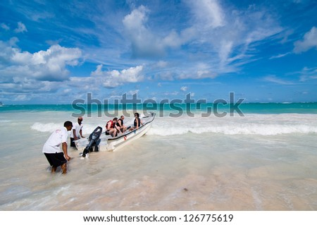 PUNTA CANA, DOMINICAN REPUBLIC - DECEMBER 11: Playa Bavaro on December 11, 2011 in Punta Cana, Dominican Republic. Playa Bavaro features over six miles of sea shore. - stock photo