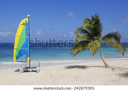 PUNTA CANA, DOMINICAN REPUBLIC - JANUARY 1, 2015: Hobie Cat catamaran ready for tourists at Bavaro Beach in Punta Cana. The Dominican Republic is the most visited destination in the Caribbean  - stock photo