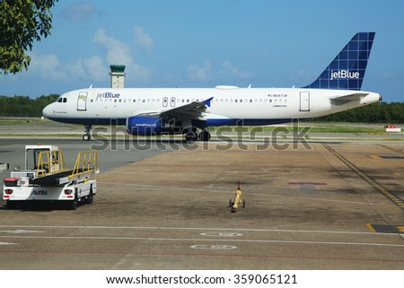 PUNTA CANA, DOMINICAN REPUBLIC - JANUARY 4, 2016: Jetblue Airlines Airbus 320 on tarmac at Punta Cana International Airport. The Dominican Republic is the most visited destination in the Caribbean - stock photo