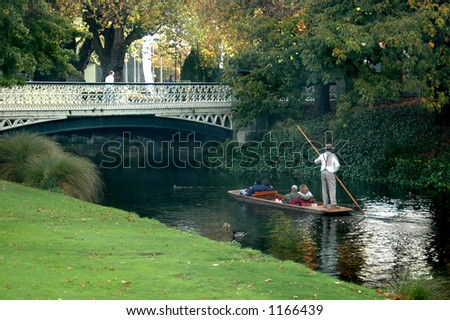 Punting on a river - stock photo