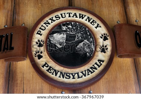 PUNXSUTAWNEY, PA - MARCH 29: Sign at Phils Burrow in downtown Punxsutawney, PA on March 29, 2015. The sign depicts a scene with Bill Murray from the popular movie Groundhog Day. - stock photo