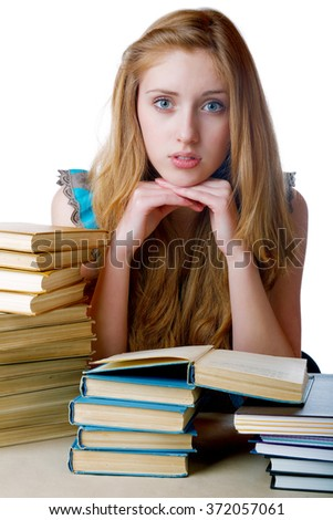 pupil among the books on a white background