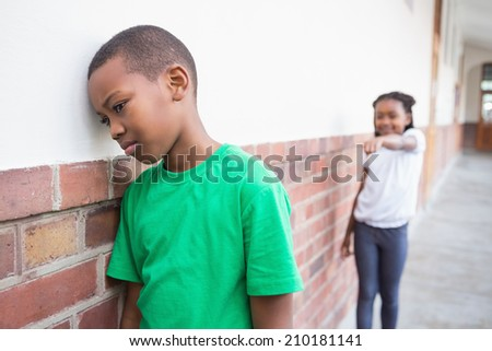 Pupil bullying another in the hall at the elementary school - stock photo