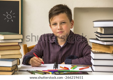 Pupil elementary school does homework. - stock photo