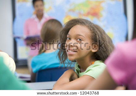 Pupil in elementary geography class - stock photo
