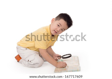 Pupil studies something with the help of magnifying glass, isolated, white background - stock photo