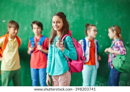 Pupil with backpack - stock photo