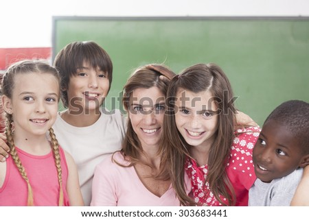 Pupils and teacher looking at camera