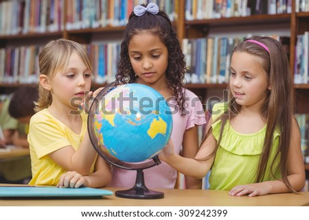 Pupils in library with globe at the elementary school