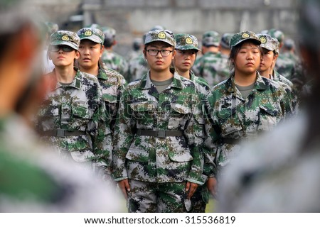 Pupils of university  take part in military training in Xiangyang, Hubei province, China on 7th Sep 2015.  - stock photo