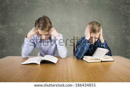 Pupils read books - stock photo