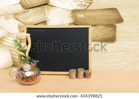 puppet doll and coins with blur credit card background - stock photo