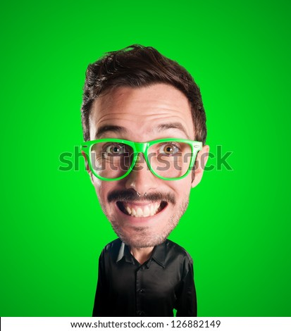 puppet man with big head on green background