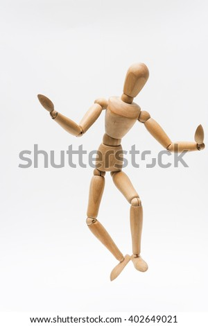 Puppet manipulation/Person represented by a wooden dummy being manipulated as a puppet with invisible strings.