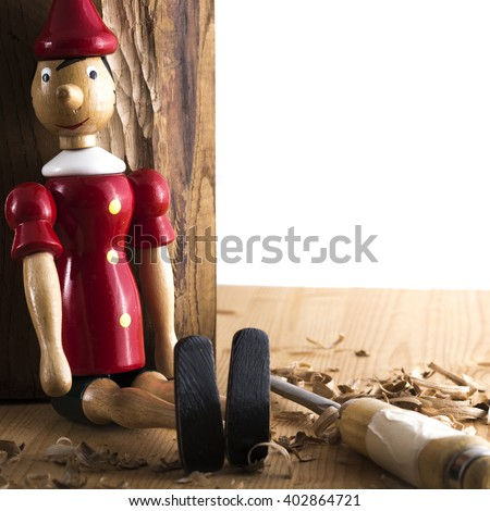 Puppet Pinocchio made of wood and then painted on a white background - stock photo