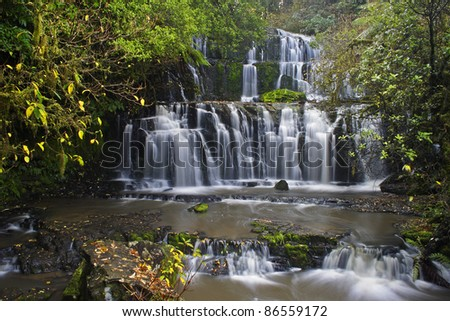 Purakaunui falls in the Otago region of the Catlins on the South island of New Zealand - stock photo
