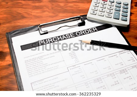 Purchase order form with pencil and calculator on wooden table selective focus