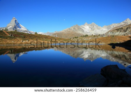 Pure Alps ~  Amazing view of Mountain Matterhorn & Lake Leisee - famous mount in Swiss Alps - stock photo