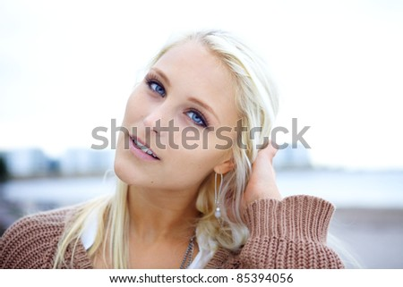 Pure and natural girl on a beach. - stock photo