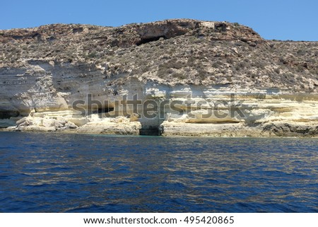 Pure crystalline water surface around an island (Lampedusa)