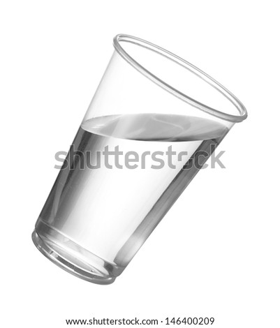 Pure drinking water in disposable cup or glass with water starting to spill over edge of pint glass - stock photo