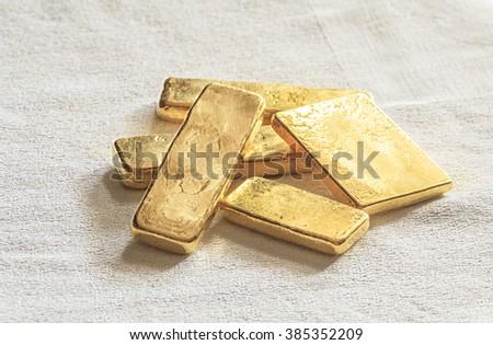 Pure ingots gold on the white background - stock photo