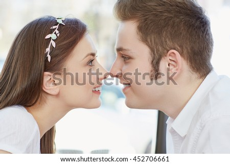 Pure love. Closeup portrait of a beautiful affectionate couple in love rubbing noses smiling joyfully - stock photo