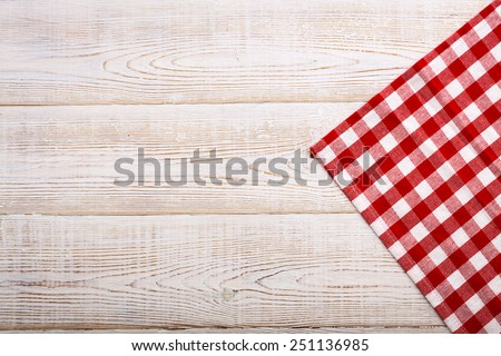 Pure notebook for recording menu, recipe on red checkered tablecloth tartan. Wooden table close up view from top  - stock photo